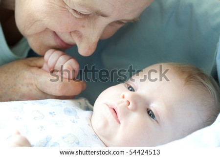 Portrait baby with happy grandmother - stock photo