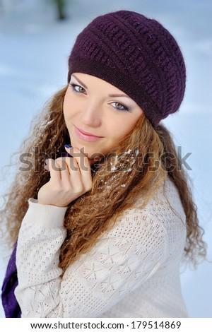 Portrait Beautiful brunette girl on a walk in winter. - stock photo