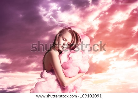 Portrait beautiful girl on pink clouds, fantastic dreams - stock photo