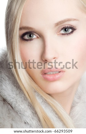 Portrait beautiful girl wearing white fur - stock photo