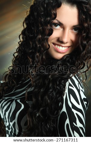 portrait beautiful girl with curly hair in studio shooting .  beautiful makeup, bright emotions - stock photo