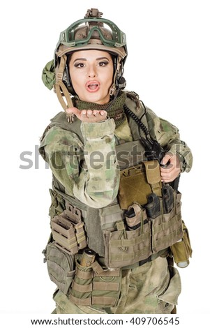 Portrait beautiful soldier or private military contractor sending an air kiss, army, weapon, technology and people concept. Image on a white background.