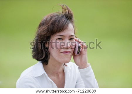 portrait Beautiful woman calling by phone - stock photo