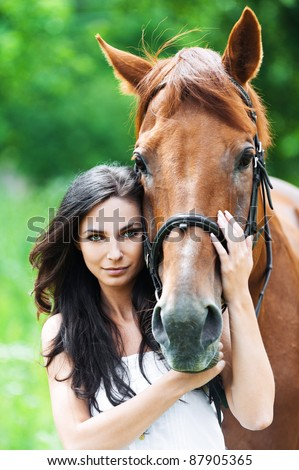 portrait beautiful woman long hair next horse - stock photo