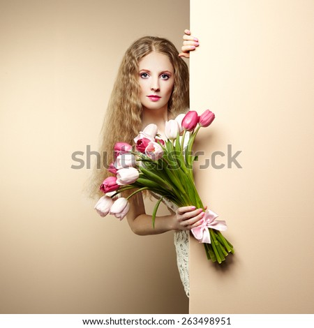 Portrait beautiful woman with bouquet of flowers. Tulips. Blonde girl. March 8. Text background - stock photo