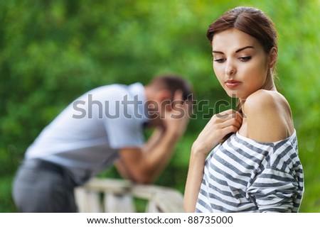 portrait beautiful young couple man woman quarreled background summer green park - stock photo