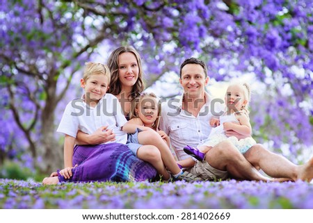 portrait beautiful young family of five  - stock photo