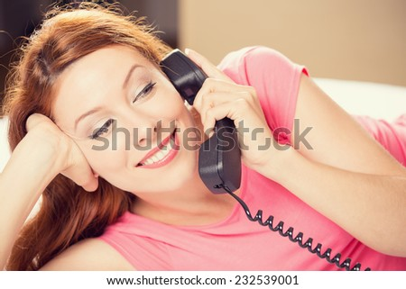 Portrait beautiful young happy woman talking on a phone lying in bed making hotel room service oder. Positive human face expression emotion feeling. Communication, leisure, travel concept