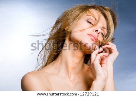 Portrait beautiful young woman enjoying the wind - stock photo