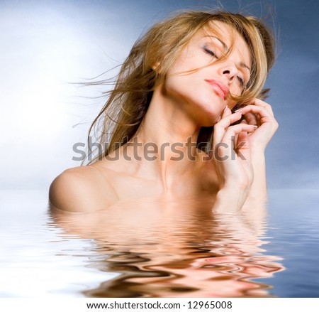 Portrait beautiful young woman in the water - stock photo