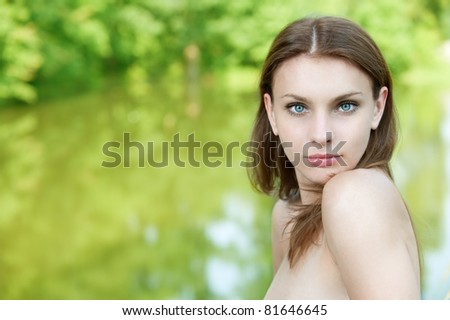 portrait beautiful young woman on green background - stock photo