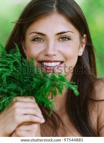 portrait beautiful young woman smiling holding bunch green dill background summer green park - stock photo