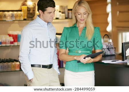 Portrait Beauty Product Shop Managers Using Digital Tablet - stock photo
