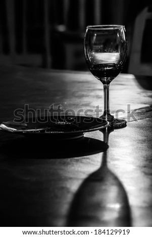 portrait black and white wine glass on table , concept and idea. - stock photo
