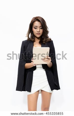 Portrait business woman using tablet. young Asian woman professional isolated on white background. - stock photo