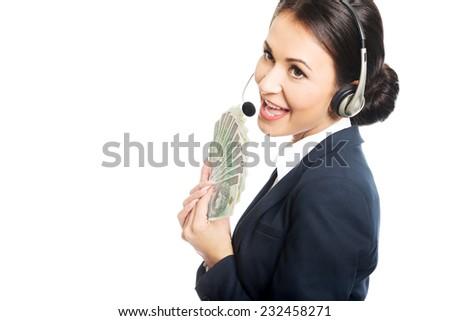 Portrait call center woman holding a clip of polish money. - stock photo