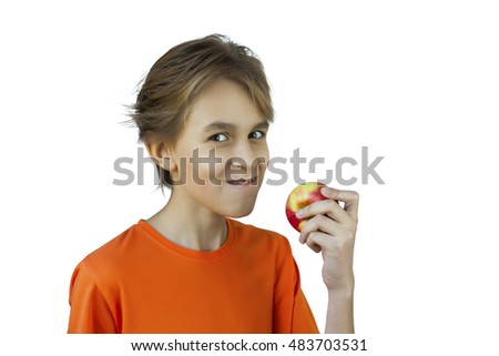 Portrait casual young man eating apple, against a white wall