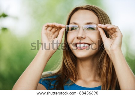 portrait charming young woman glasses smiling background summer nature - stock photo