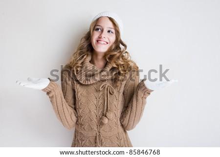 Portrait cheerful gesturing winter fashion girl. - stock photo