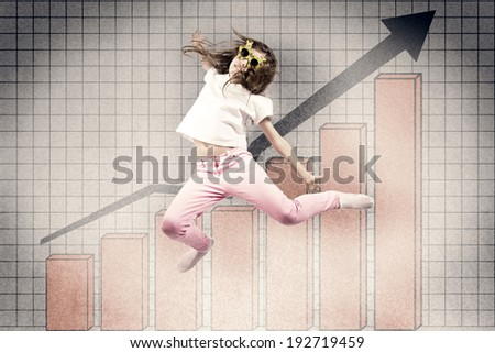 Portrait cheerful, happy, excited, joyful little girl with summer sunglasses, jumping against  background with profit, grades growth chart. Positive human emotion expression, reaction, life perception - stock photo