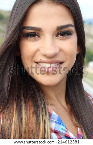 Portrait close up of beautiful young girl brunette outdoors