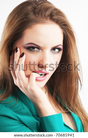 Portrait close up of the sensual girl with a little finger in a mouth - stock photo
