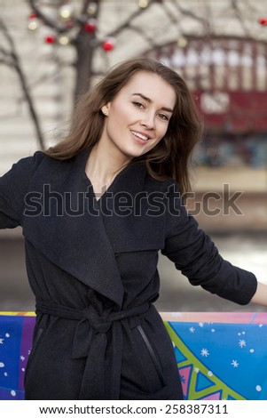 Portrait close up of young beautiful blonde woman, on winter street background - stock photo