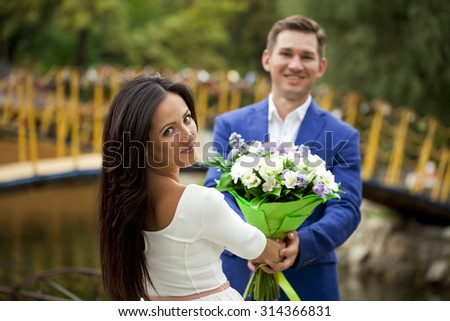 Portrait close up of young beautiful brunette woman in white dress on background of autumn park - stock photo
