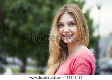Portrait close up of young beautiful happy woman, summer outdoors