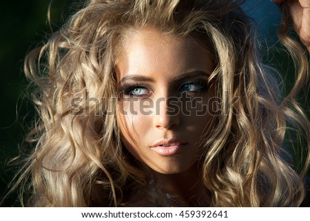 Portrait close up of young beautiful woman - stock photo