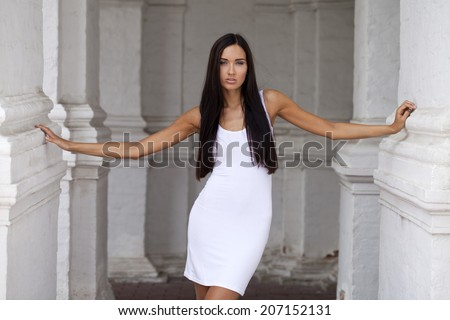 Portrait close up of young beautiful woman in white dress - stock photo