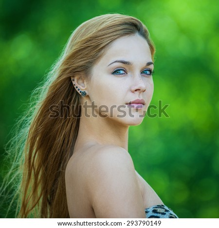 Portrait close up of young beautiful woman, on green background summer nature. - stock photo