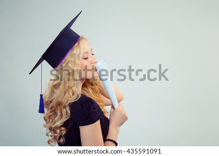 Portrait closeup beautiful happy glad latina graduate, graduated student girl young woman in cap gown turning kissing her diploma scroll isolated green background wall. Celebrating graduation ceremony - stock photo