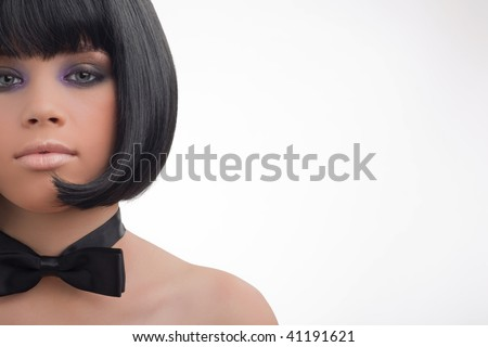 Portrait closeup of the young girl in style of a retro. - stock photo