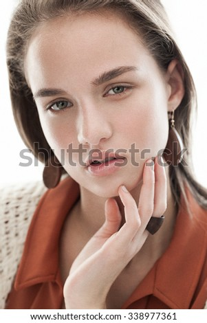 Portrait closeup of young beautiful woman with natural beauty, nude makeup, long straight hair. Looking at camera, posing. - stock photo