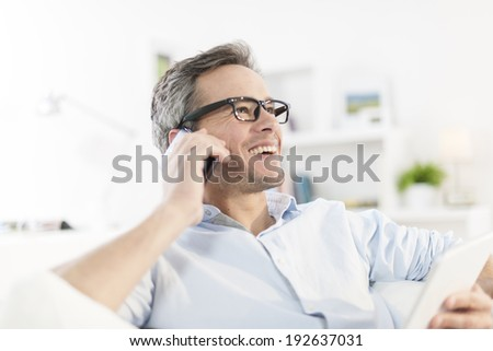 portrait closeup on a man at phone - stock photo