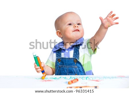 Portrait clouse-up of little sweet boy draws with crayons in red, isolated on white