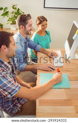 Portrait colleagues using a computer at the office - stock photo