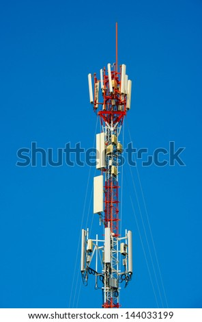 portrait communications tower on blue sky