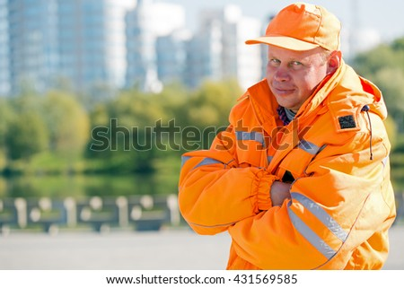 Portrait construction man worker or city yardman landscaper on town background - stock photo