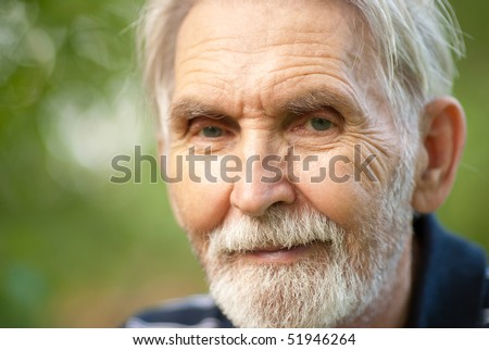 Portrait courageous seniors against summer personal plot. - stock photo