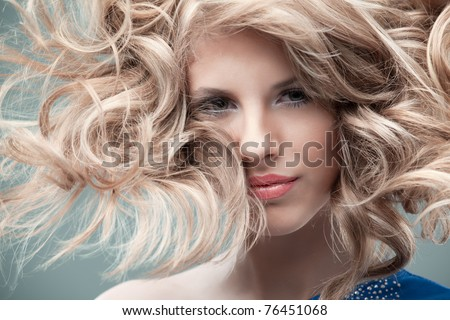 portrait curly blonde wind hair