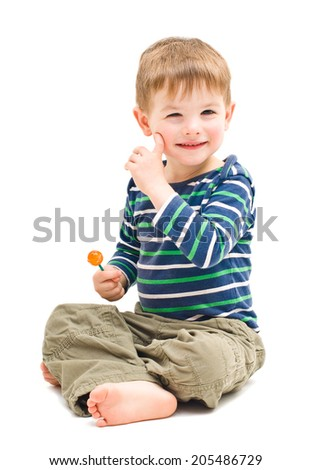 Portrait cute cheerful boy sitting with  lollipop - stock photo
