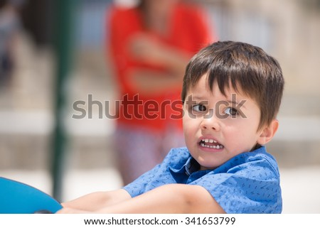 Portrait cute latino boy looking sad, worried and unhappy outdoors, blurred background, copy space. - stock photo