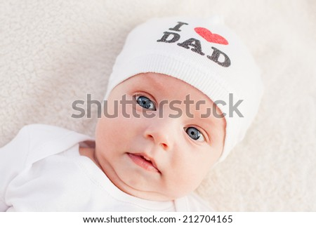 portrait cute newborn baby wearing hat (not a trademark) - stock photo