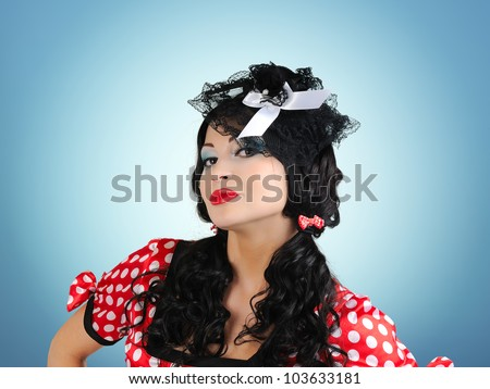 Portrait elegant young pin-up style girl - stock photo