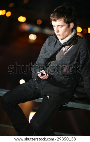 Portrait. Evening city lights in the background. - stock photo