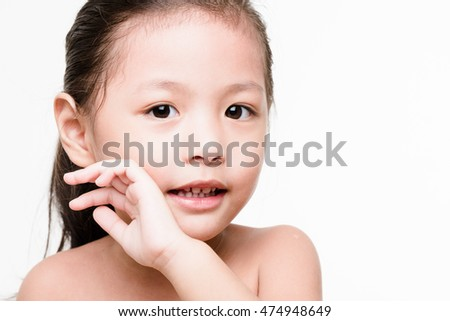 PORTRAIT : face of adorable young Asian girl with black hair on white background
