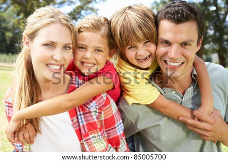 Portrait family outdoors - stock photo