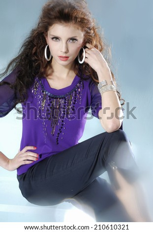 portrait fashion model sitting cube on light background - stock photo